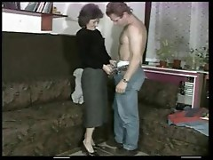Skinny MILF with small droopy tits gets fucked by a younger man